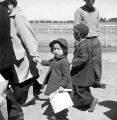 Dorothea Lange - Family of Japanese ancestry arrives at assembly center at Tanforan Race Track. 1942